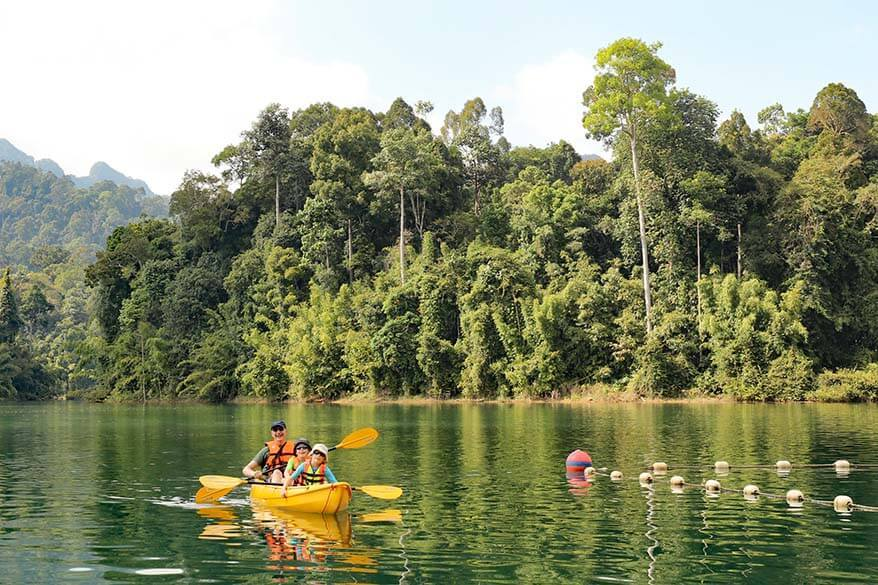 Family kayaking at the Rainforest Camp at Elephant Hills resort Thailand