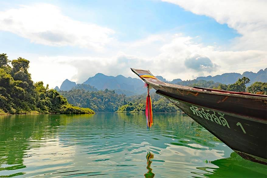 Long tail boat on Cheow Lan Lake in Khao Sok National Park Thailand