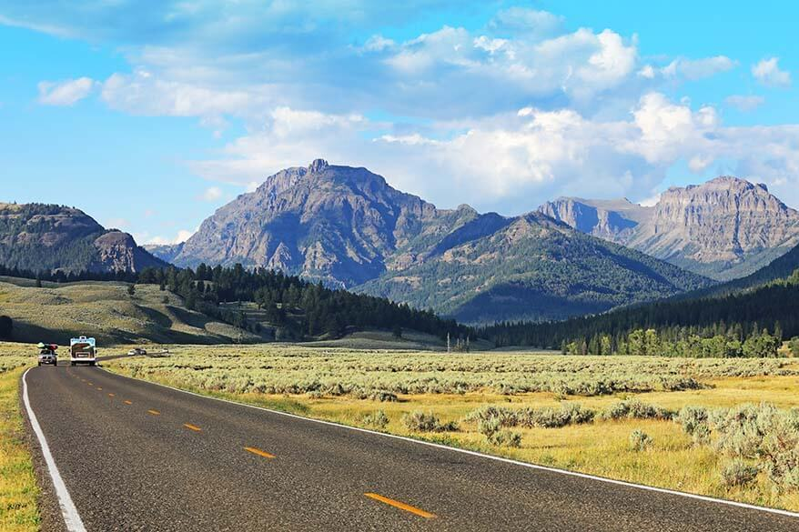 Scenic road with mountain views leading from Lamar Valley to the Northeast Entrance Gate of Yellowstone