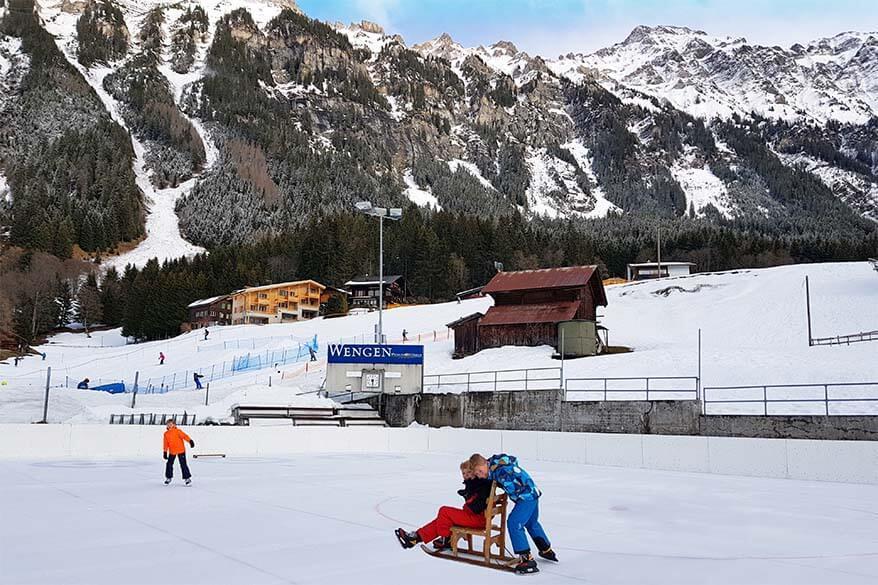 Kids ice skating in Wengen Switzerland