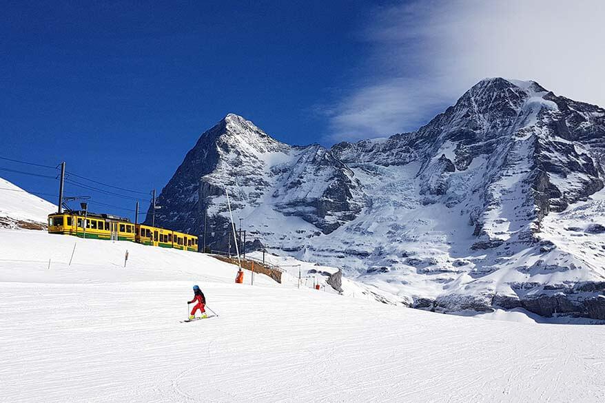 Skiing near Kleine Scheidegg in Jungfrau in winter - Switzerland