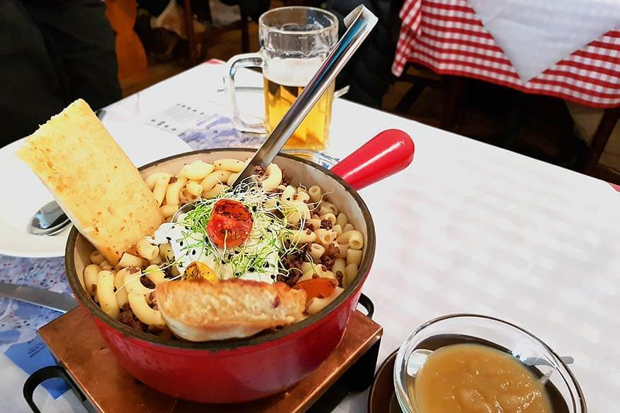Traditional Swiss dish Ghackets mit Hörnli at a local restaurant in Wengen, Jungfrau Region, Switzerland