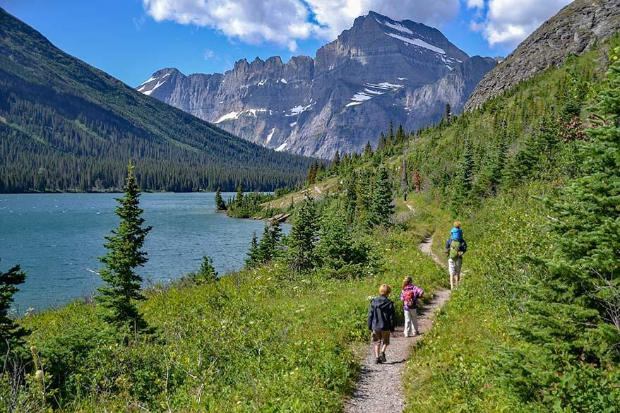 Hiking along Lake Josephine towards Grinnell Glacier