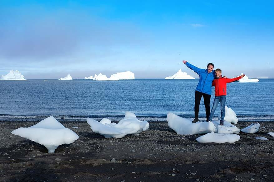 Family trip to Greenland - icebergs on a black sand beach on Disko Island