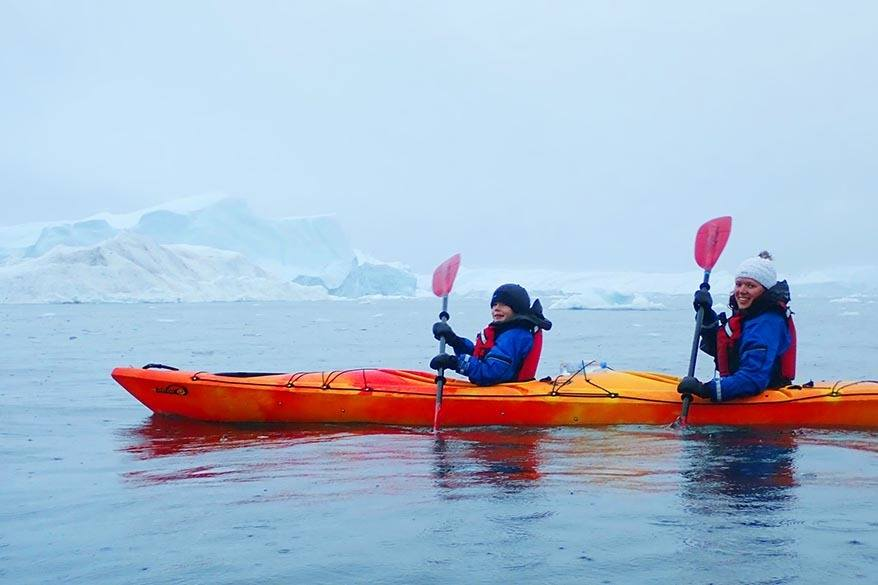 Kayaking between icebergs in Greenland