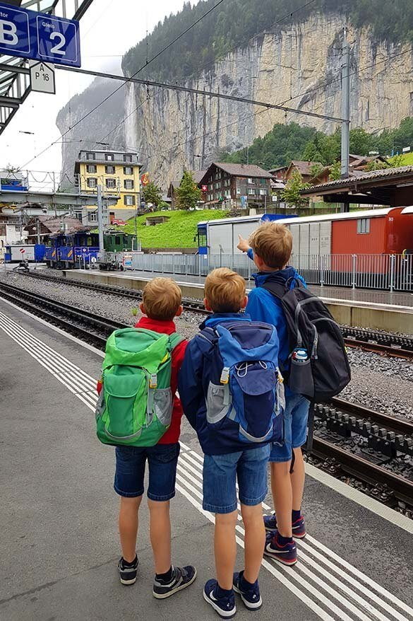 Kids with travel backpacks in Switzerland
