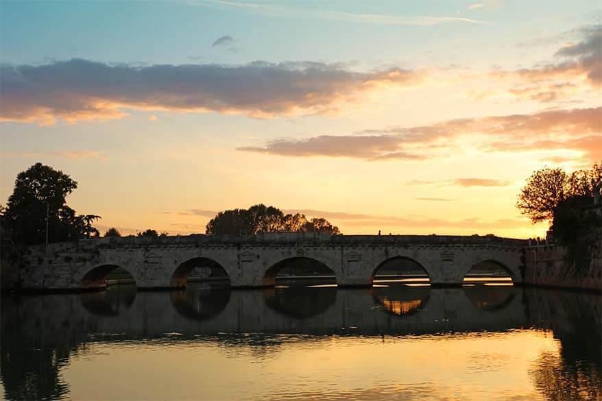 Tiberius Bridge in Rimini at sunset
