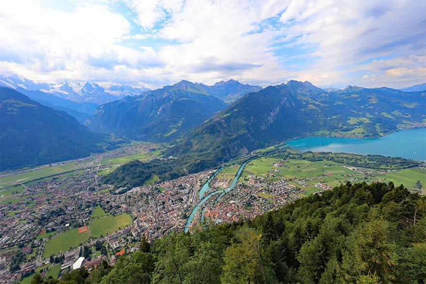 Interlaken town, Lake Thun, and the mountains of Jungfrau Region as seen from Harder Kulm in Interlaken