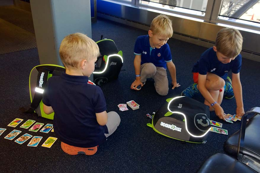 Kids playing at the airport - tips for flying with children