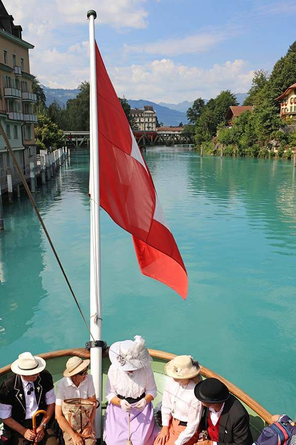 People in Belle-Epoque style clothing on a historic boat on Lake Brienz in Interlaken Switzerland