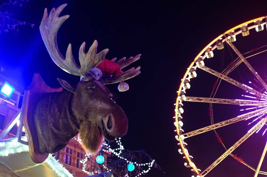 Fun market stall with a moose at Brussels Ferris wheel during Winter Wonders festive season in Belgium