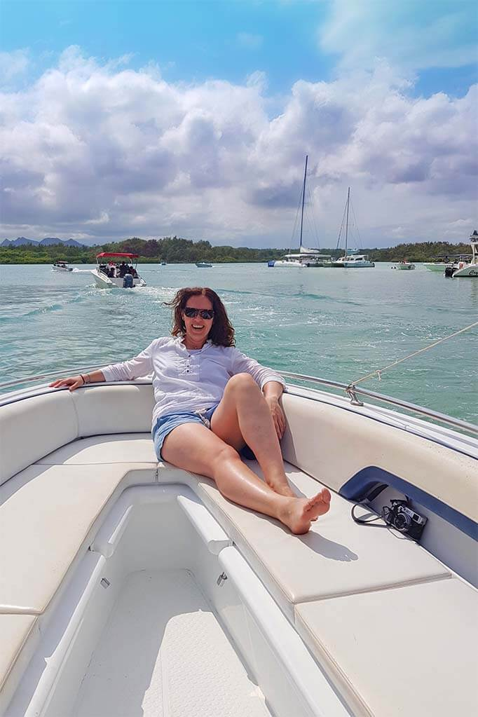 Jurga from Full Suitcase on a speedboat in Mauritius