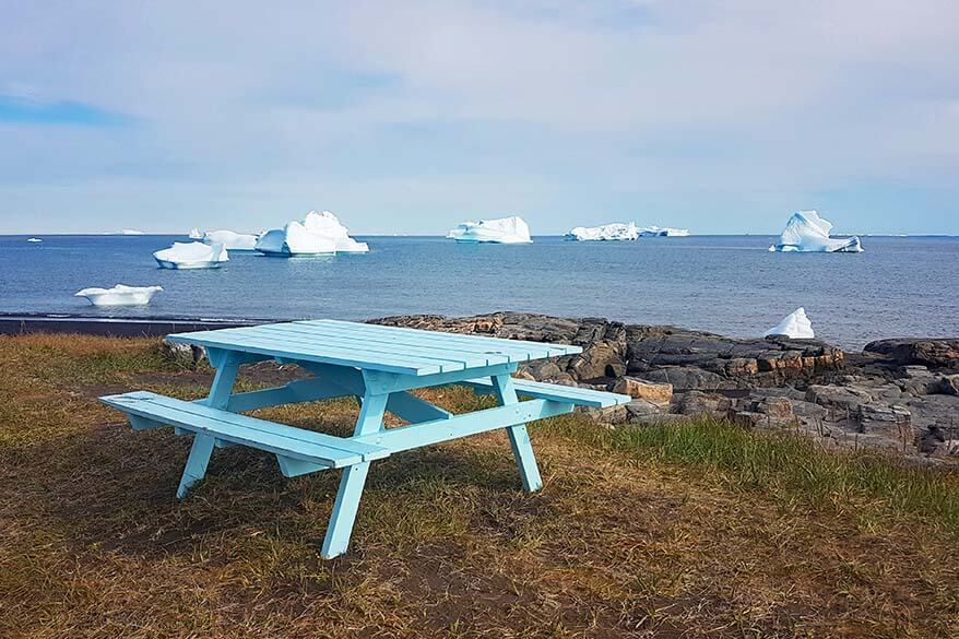 Picnic table with icebergs in the background - Disko Island Greenland