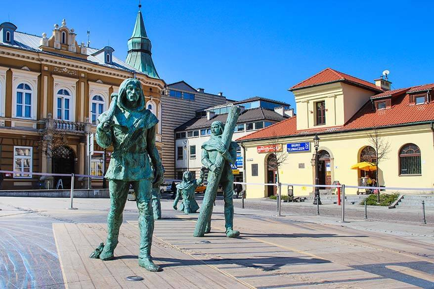 Miners sculptures on the market square in Wieliczka town in Poland