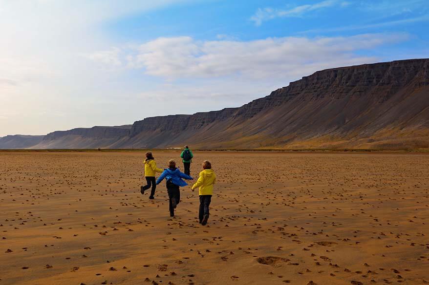Walking on Raudasandur beach with kids