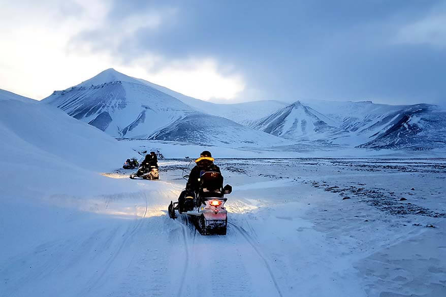 Snowmobiling in Svalbard in winter