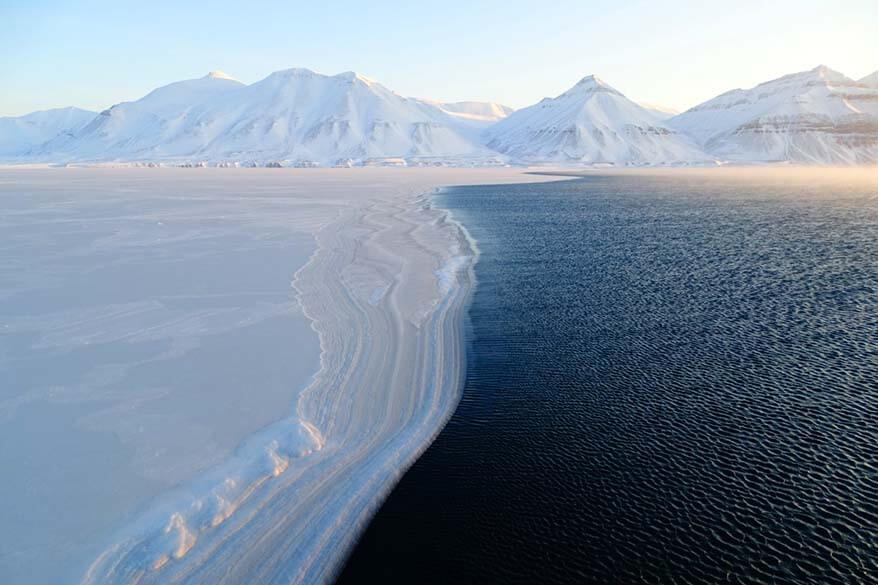 Ice meets the ocean - frozen Arctic sea near Pyramiden in winter