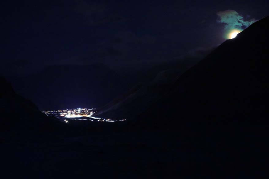 Longyearbyen town as seen from a nearby mountain during a snowmobile tour at night