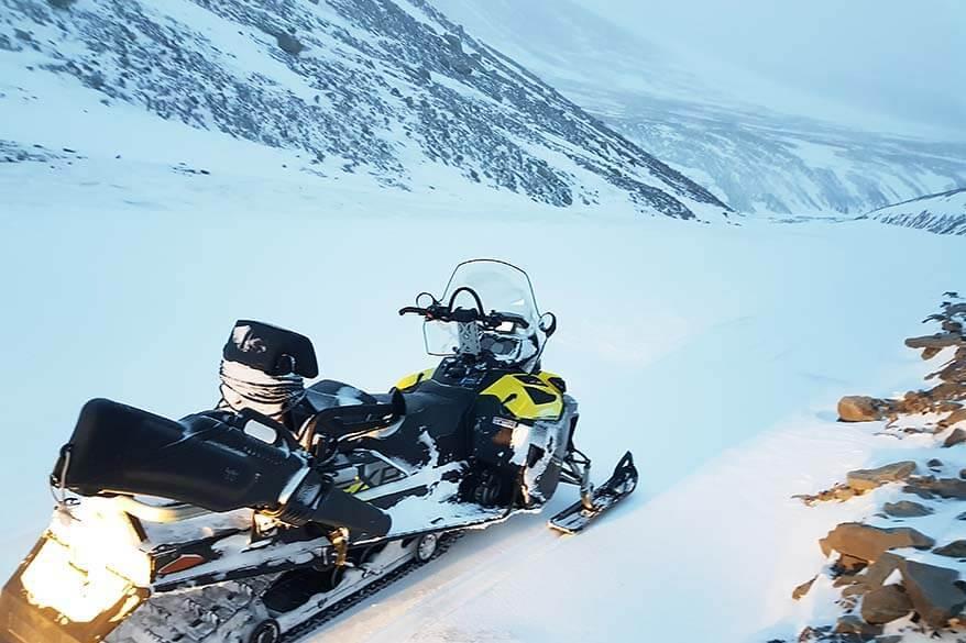 Snowmobile safari tour guides carry guns for polar bear protection