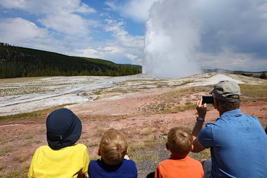 Watching the Old Faithful eruption from the viewing area