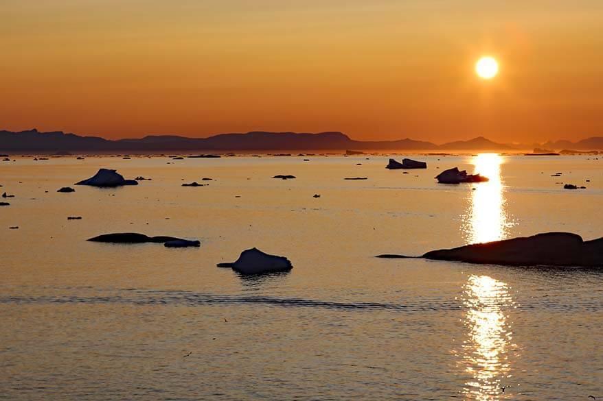 Icebergs and midnight sun in Ilulissat