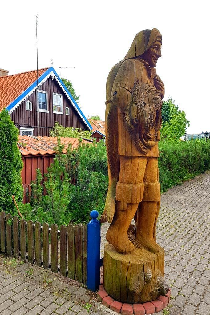 Wooden sculpture of a fisherman in Preila, Lithuania