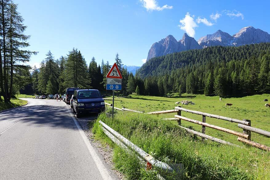 Cars parked on the street at Lago di Sorapis hike trailhead at Passo Tre Croci