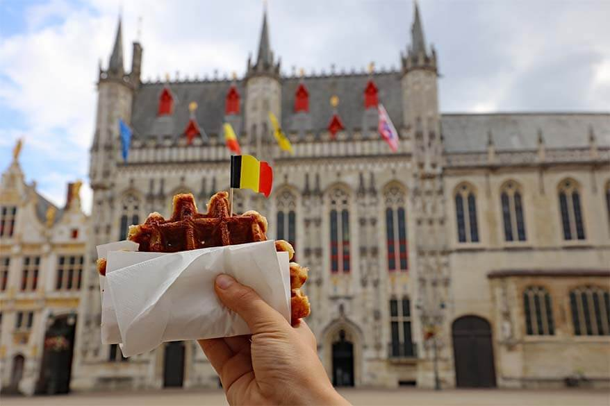 Belgian waffle with Bruges City Hall in the background