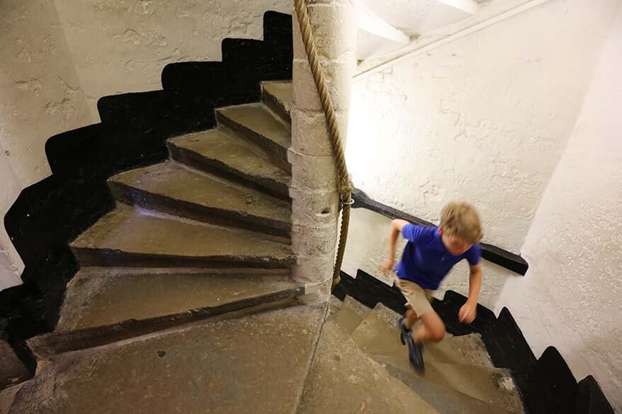 Child climbing the stairs of Belfort in Brugge
