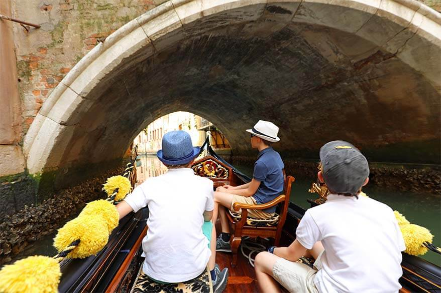 Gondola ride under a bridge in Venice