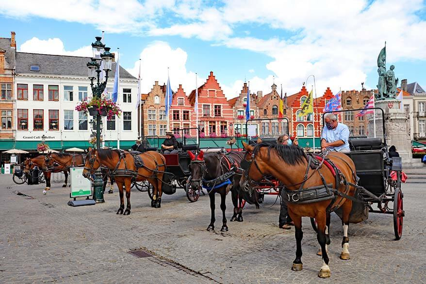 Horses and carriages on the Market Square in Bruges