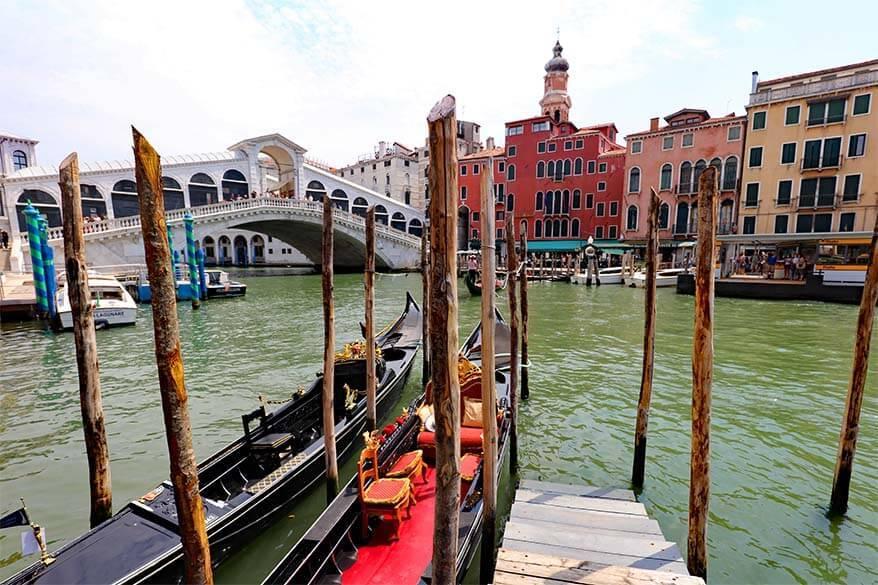 Traditional Venetian gondolas at Rialto Bridge