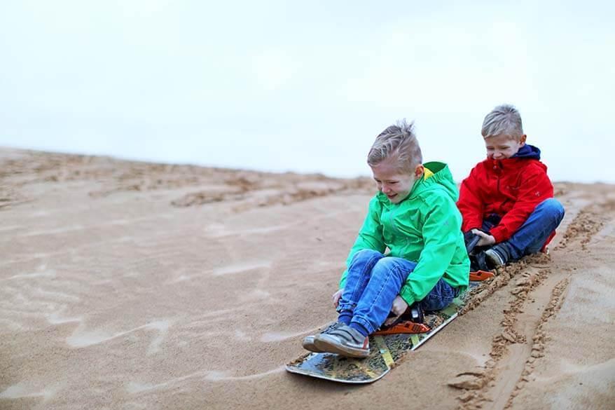 Dubai with kids - sandboarding in the desert
