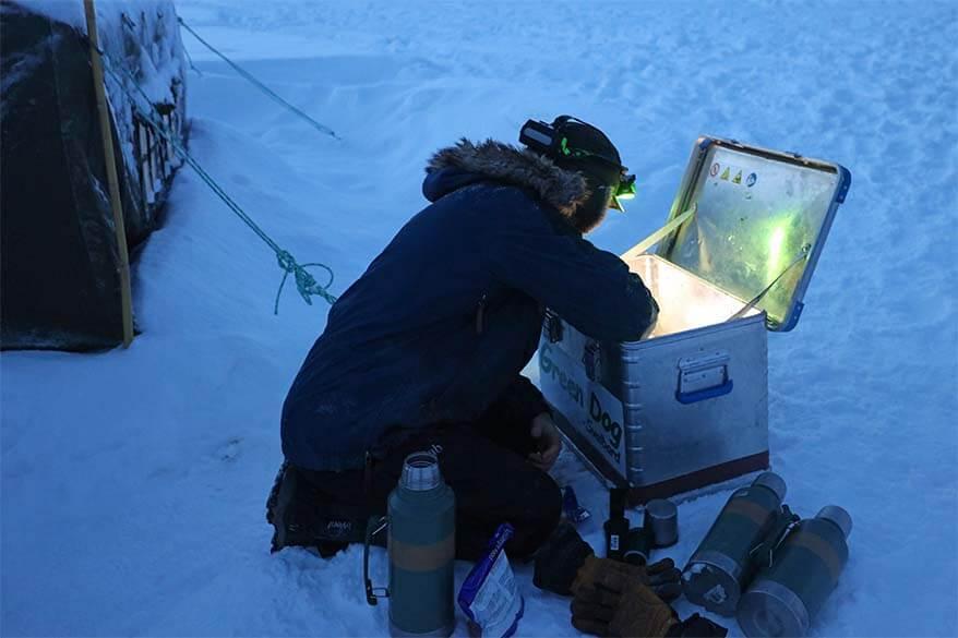 Svalbard dog sledding tour guide preparing lunch