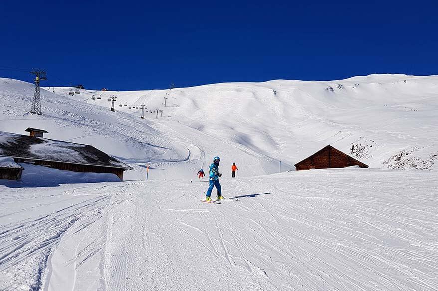 Kids skiing near Mannlichen in the Grindelwald Wengen ski area in Switzerland