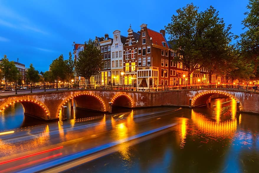 Amsterdam canals lit in the evening