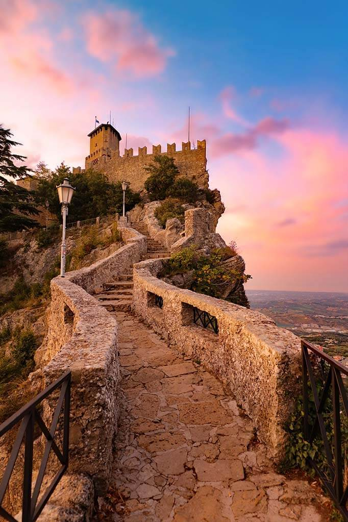 Beautiful travel pictures - San Marino towers at sunset