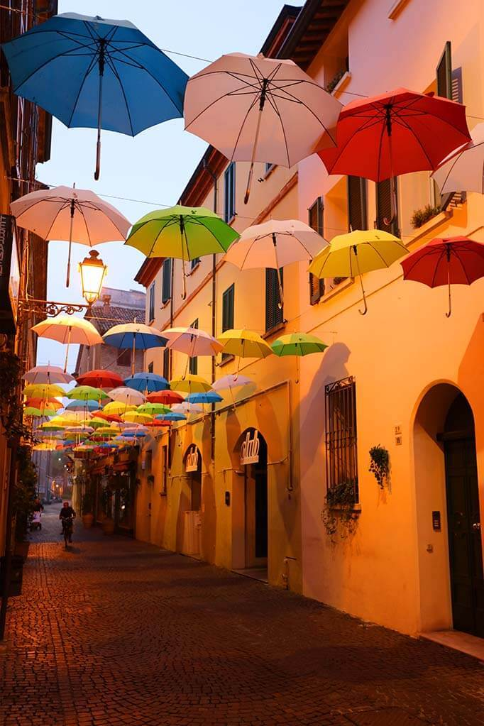 Early morning photo of an umbrella street in Ravenna city in Italy