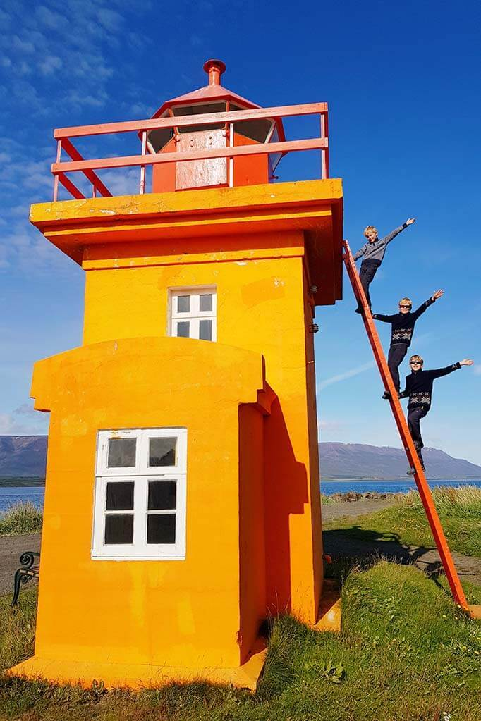 Fun travel picture of a colorful lighthouse in Iceland
