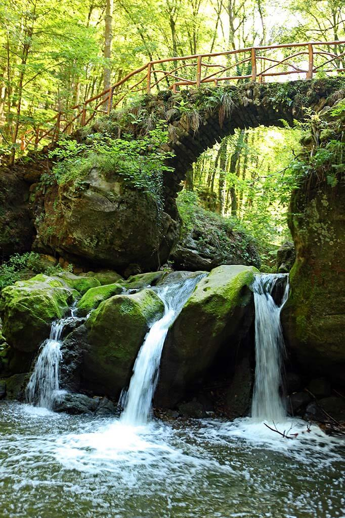Schiessentumpel waterfall at Mullerthal Trail in Luxembourg