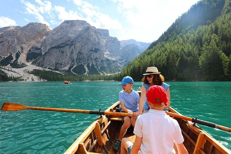 Family rowing a boat on Lago di Braies in Italy