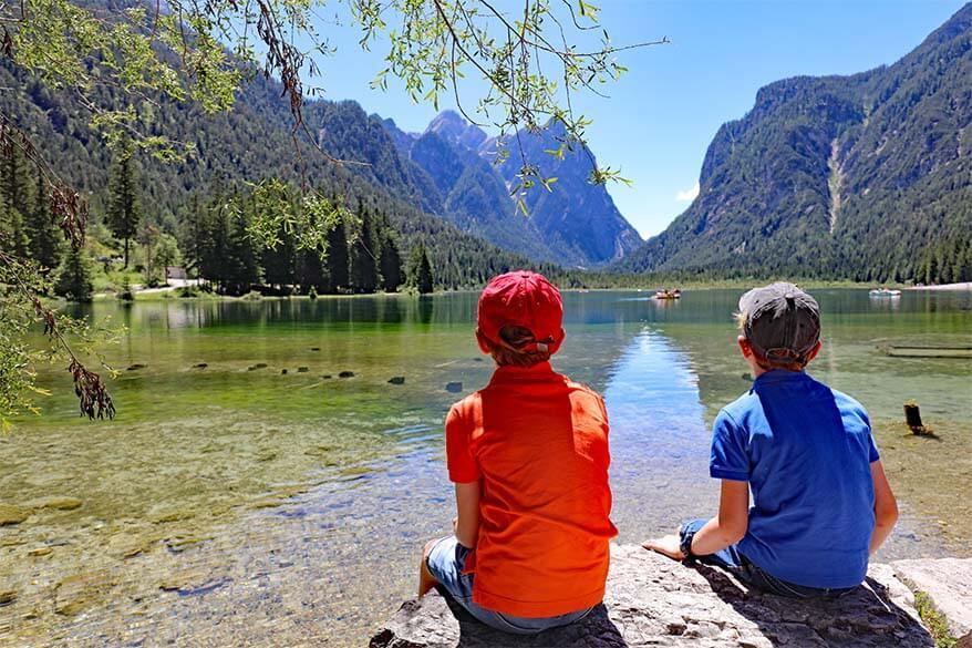 Kids enjoying the view at Lago di Dobbiaco in the Italian mountains