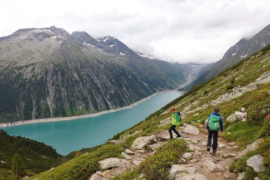 Kids hiking down from Olperer Hut to Schlegeis lake.