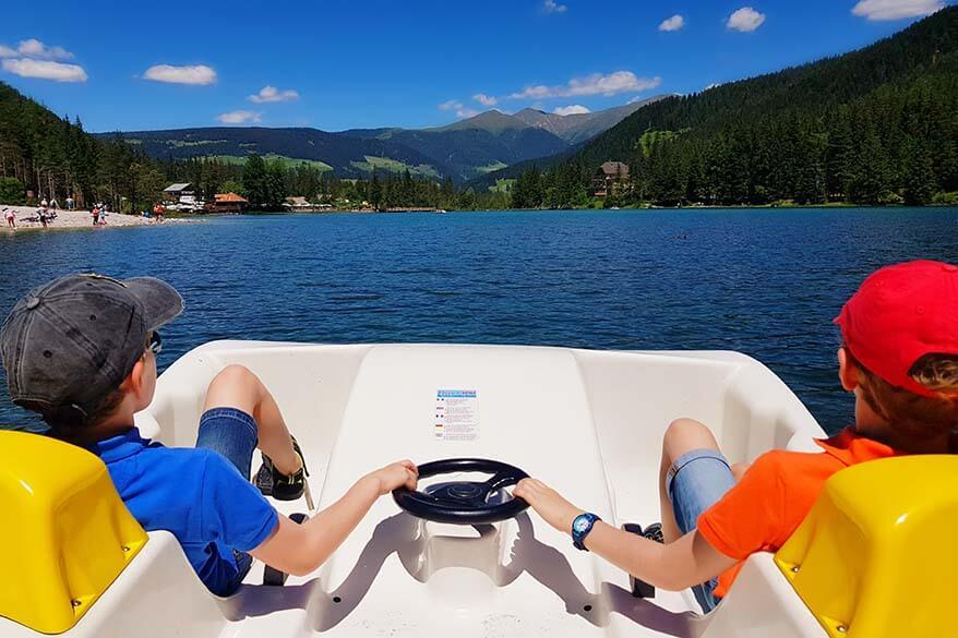 Kids on a peddle boat on Lake Dobbiaco in Italy
