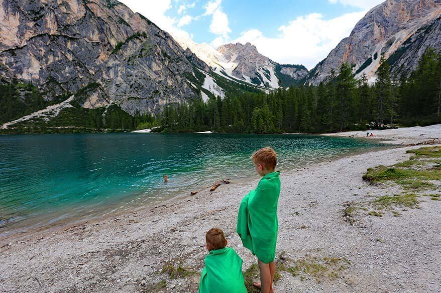 Kids swimming at Lago di Braies in summer