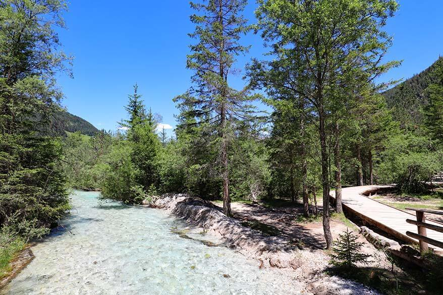 Mountain river and hiking trail at Lago di Dobbiaco