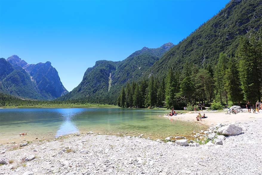 Small pebble beach at Lago di Dobbiaco in Italy
