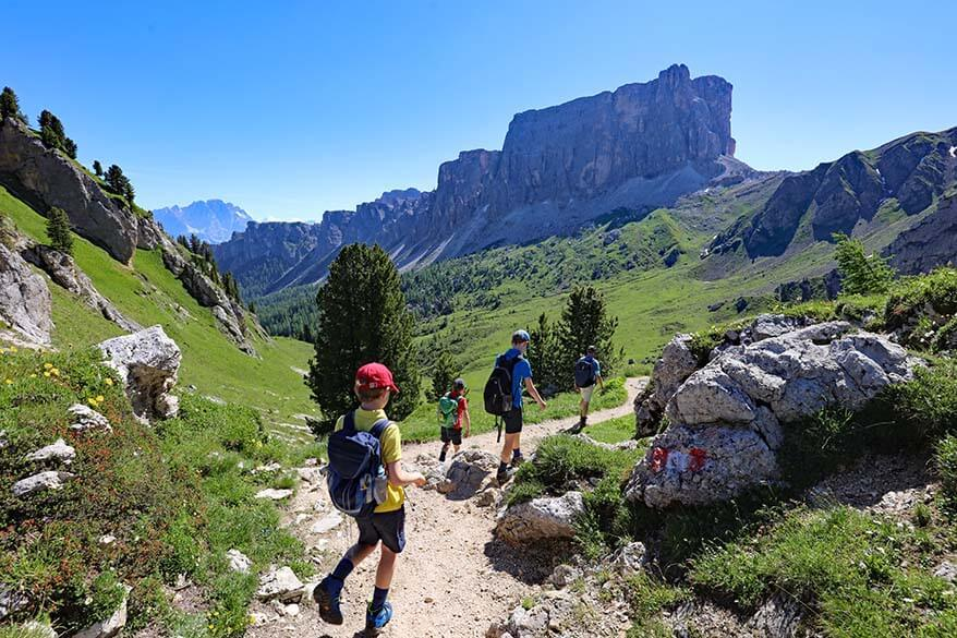 Kids hiking on the trail 436 Passo Giau