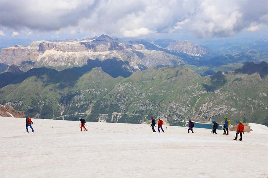People hiking on a glacier at Marmolada in Italy