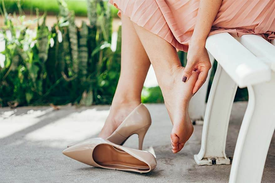 A woman with feet pain from high heel shoes